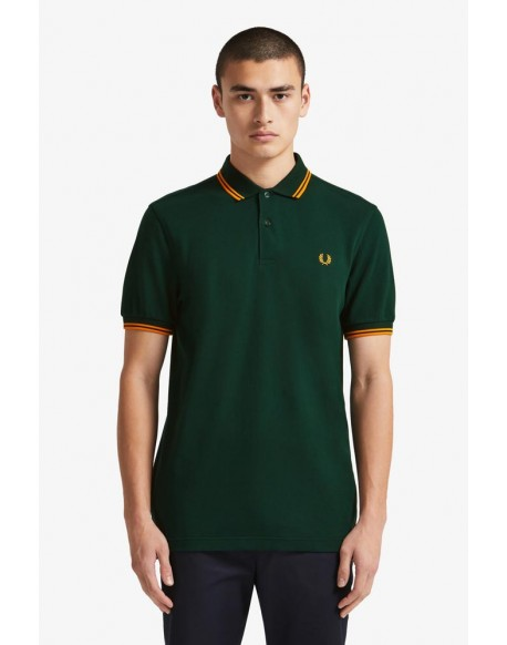 Fred Perry polo verde franjas naranjas