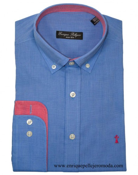 Enrique Pellejero blue shirt