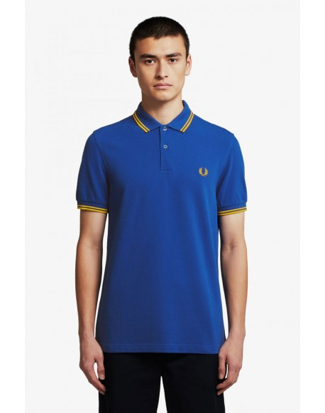 Fred Perry blue polo shirt with gold trim